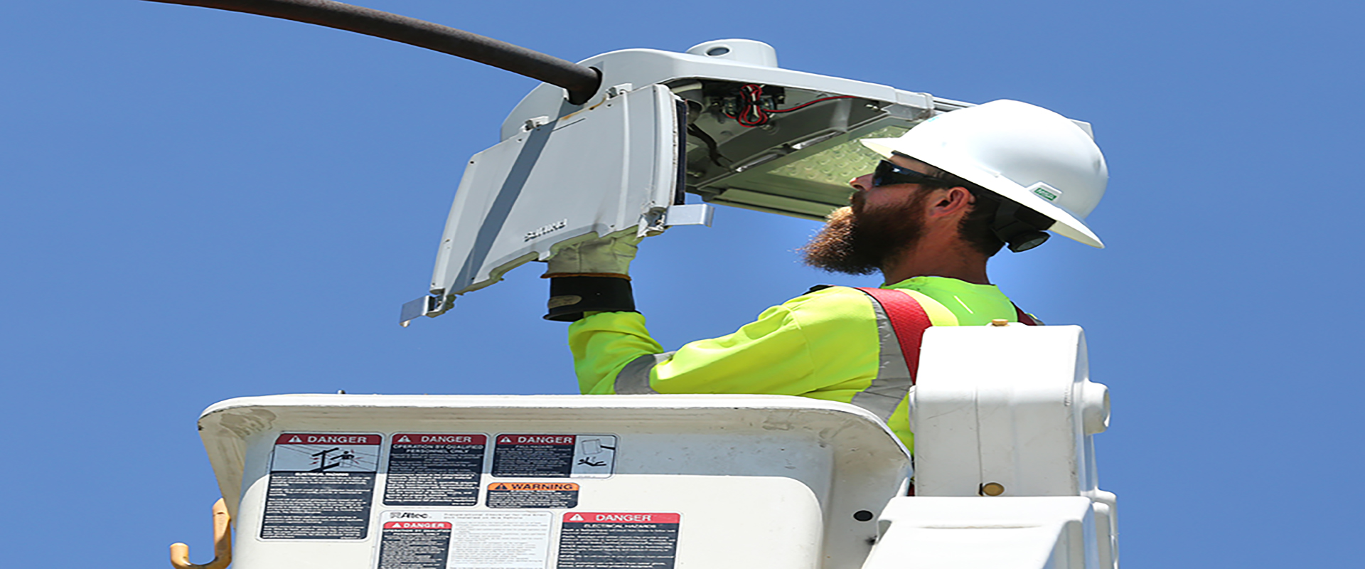Lineman installs LED Streetlight