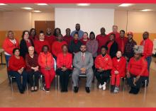Director Robert Davis and Interim Commissioner Joy Perry join employees in support of the annual Go Red campaign.